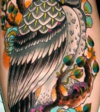Big and colorful owl tattoo