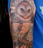 Big brown owl tattoo