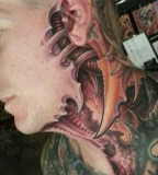 Biomech face tattoo