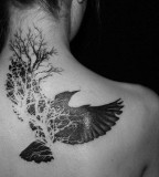 Black and white bird tattoo