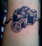 Black and white camera tattoo