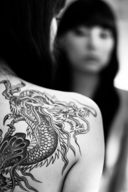 Black and white dragon tattoo