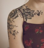 Black flowers sleeve tattoo for women