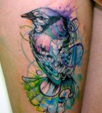 Blue and white bird tattoo
