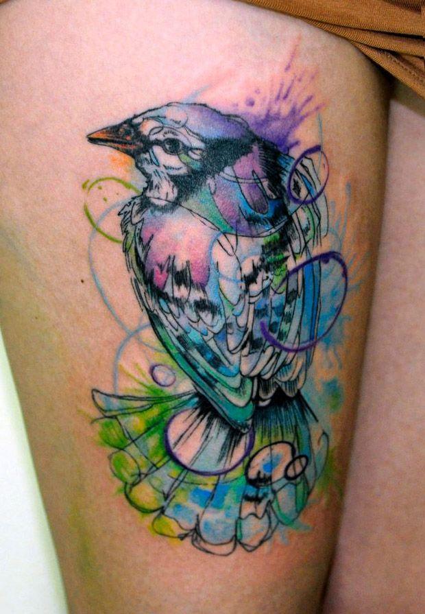Blue and white bird tattoo