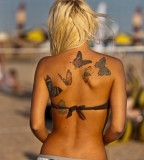 Butterfly tattoos on women back