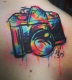 Colorful camera tattoo