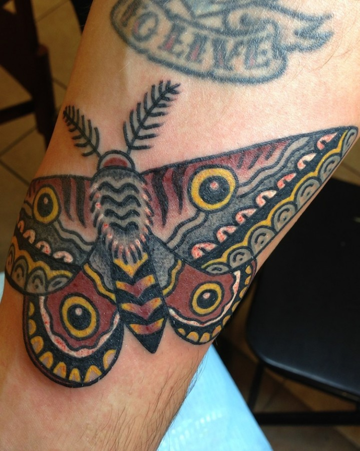 Colorful tattoos by Andy Perez butterfly