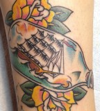 Colorful tattoos by Andy Perez  ship in the bottle