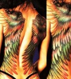Colorful wings tattoo