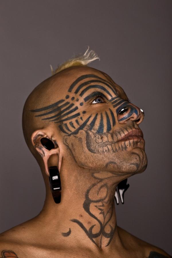 Cruel face tattoo