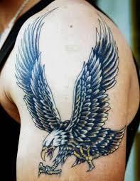 Eagle tattoo on man arm