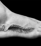 Feather foot tattoo by Ben Volt