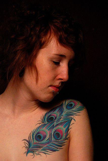 Feather tattoo on girl