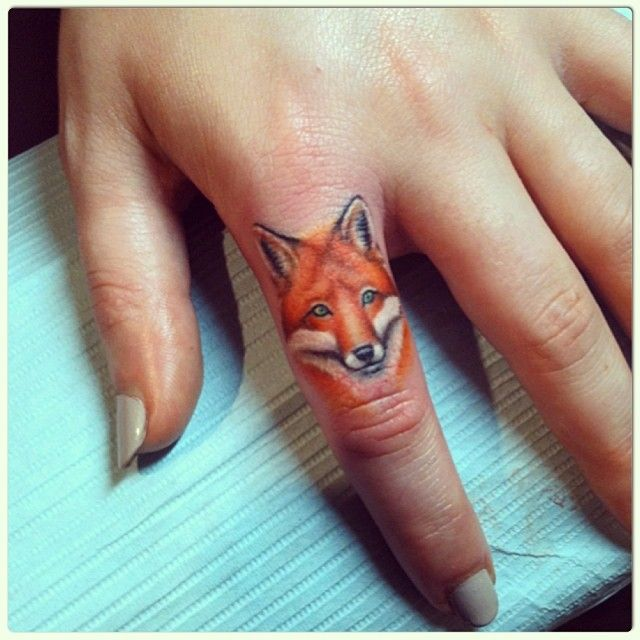Finger fox tattoos