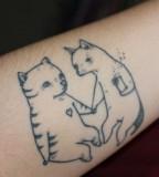Friendly cats tattoo