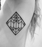 Geometric black and white tattoo