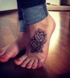 Great flowers foot tattoo