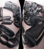 Gun tattoo by Matteo Pasqualin