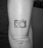 Heart and camera tattoo