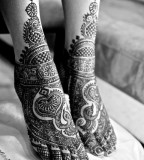 Leg with Mehendi design tattoos