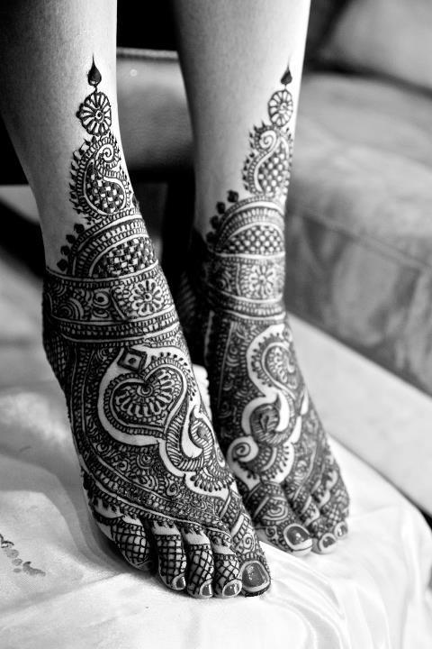 Leg with Mehendi design tattoos