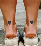 Legs heart tattoo