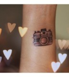 Lovely camera tattoos