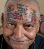 Men head with flags tattoo