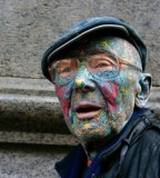 Old man colorful face tattoo