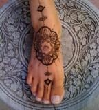 Ornaments foot tattoo