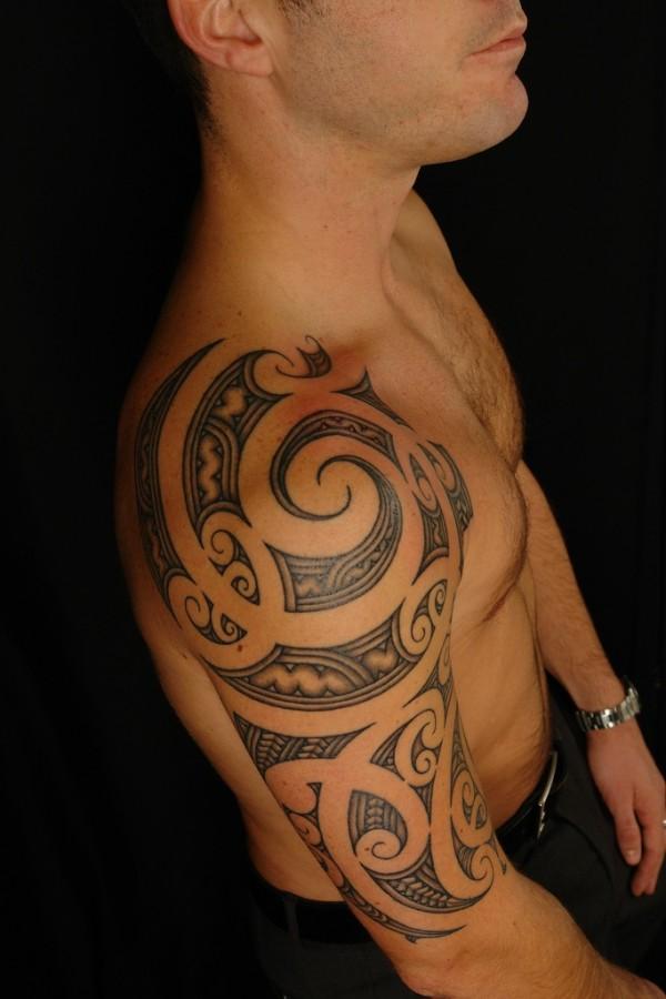 Ornaments shoulder tattoo