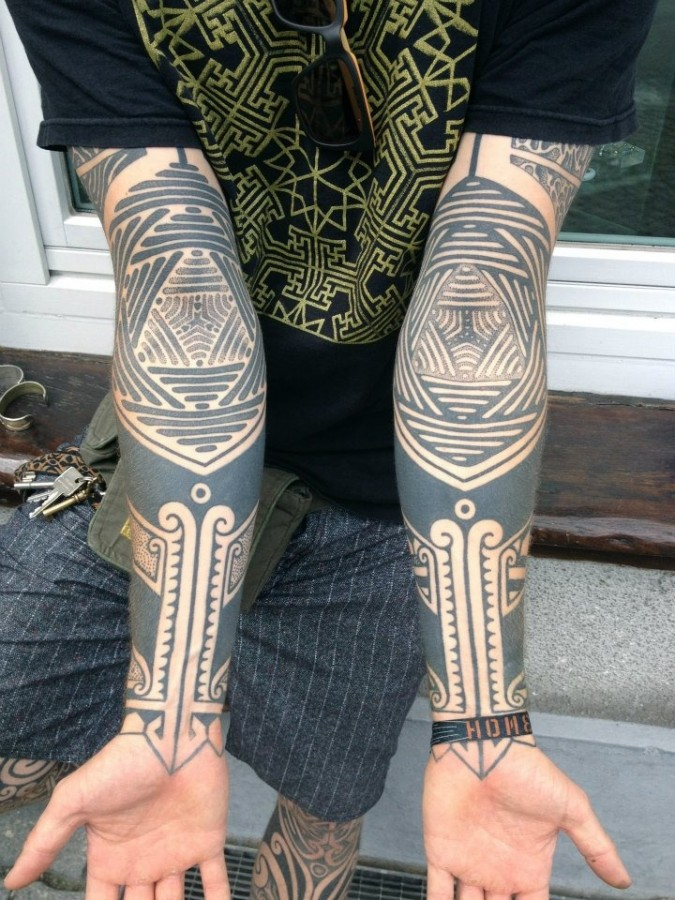 Patterned arm tattoo