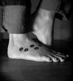 Paw print tatoo on foot