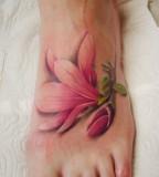 Red flowers foot tattoo
