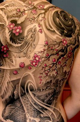 Red tree and dragon tattoo
