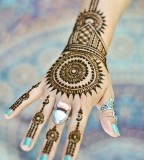 Round Mehendi design tattoos