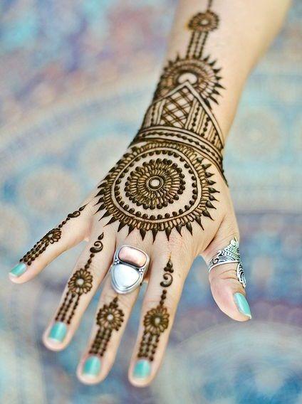 Round Mehendi design tattoos