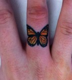Simple butterfly tattoo on finger