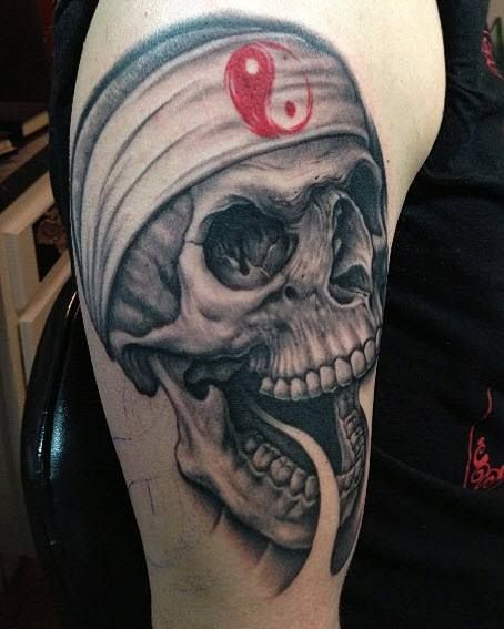 Skull tattoo by Bob Tyrell
