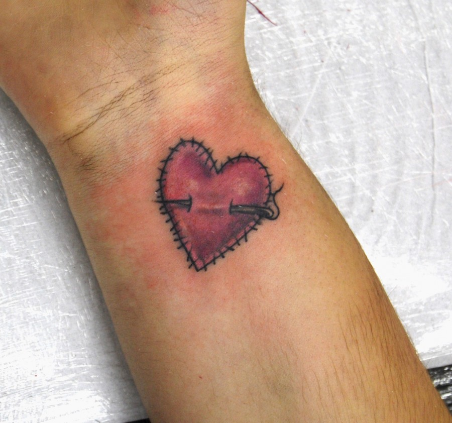 Stiched heart tattoo