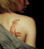 Watercolor fox tattoos on shoulder