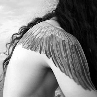 Wings shoulder tattoo