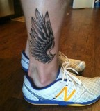Wings tattoo on leg