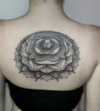 Women back tattoo by Chaim Machlev