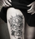 alex tabuns floral thigh tattoo