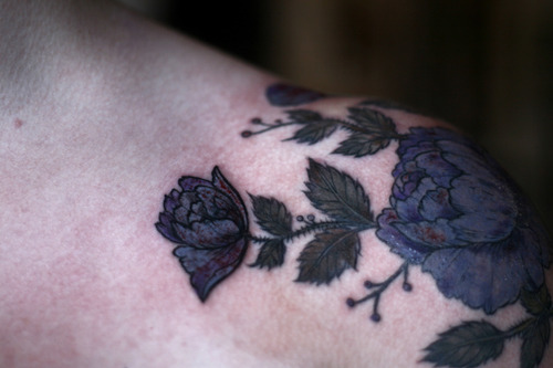 beautiful black roses tattoo on shoulder