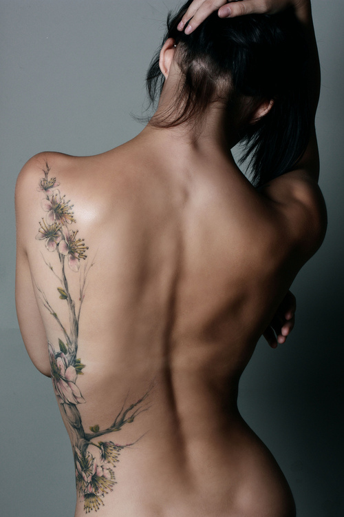 beautiful full lengh floral tattoo blossoms