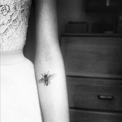 beautiful tattoo placement bee on inside arm