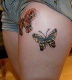 beautiful tattoo placement butterflies on upper thigh